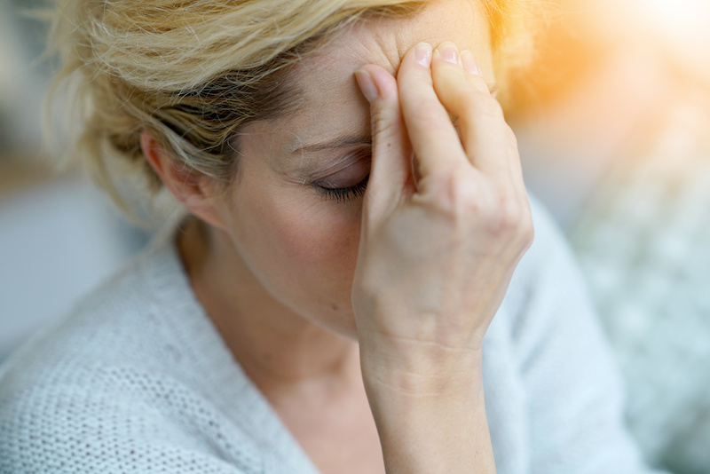 woman with migraine; treatment options for migraines