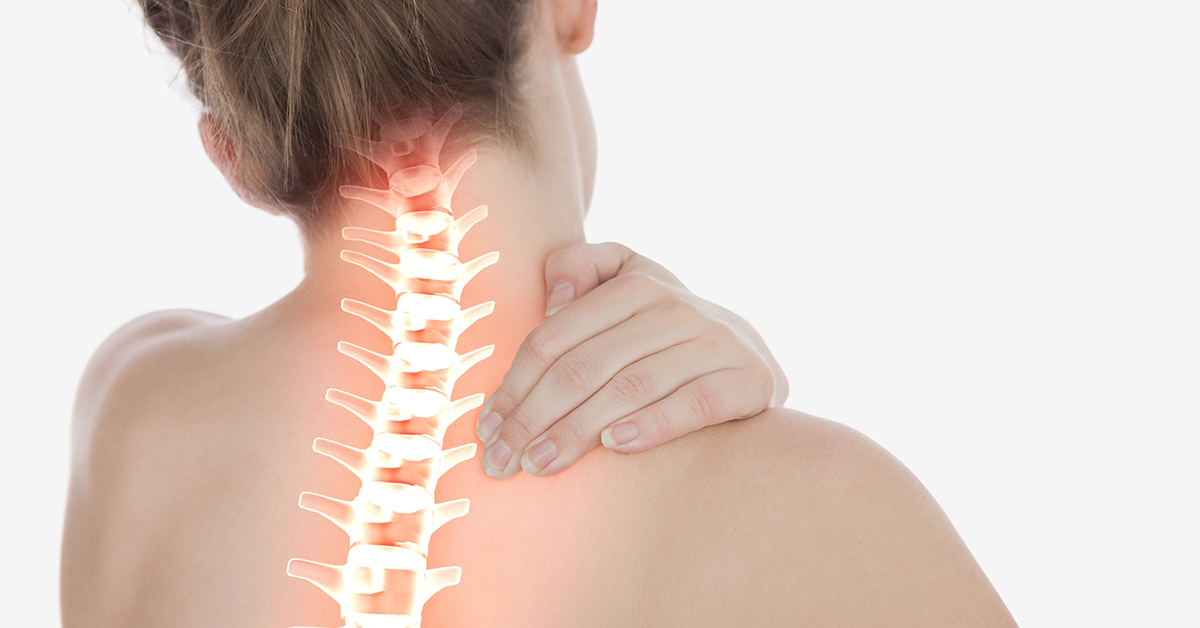 Highlighted spine of woman with neck pain; blog: when to worry about neck pain