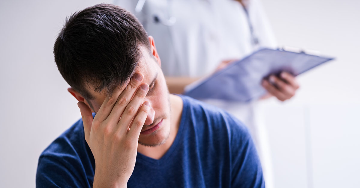 Male Patient With Headache In A Clinic; blog: 5 Depression Treatment Options