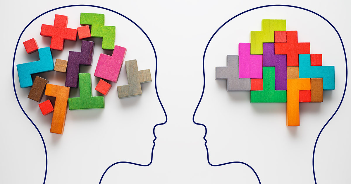 The concept of rational and irrational thinking of two people. Heads of two people with colourful shapes of abstract brain for concept of idea and teamwork. Two people with different thinking; blog: Does Brain Training Work?